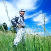 Eddie 'Rattler' Gallegos waits for some action in the tall outfield grass during the vintage baseball game between the Walker Ranch Boys and The Excelsiors at Walker Ranch in Boulder on July 25.  The Walker Ranch Boys won 19-15 in 11 innings.<br /> Greg Lindstrom / The Camera