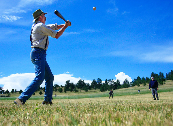 Wayne Kuhn, known as Old Growth Forest Walker, swings at a pitch from Bruce 'Old Hoss' Foster during the vintage baseball game between the Walker Ranch Boys and The Excelsiors at Walker Ranch in Boulder on July 25.<br /> Greg Lindstrom / The Camera