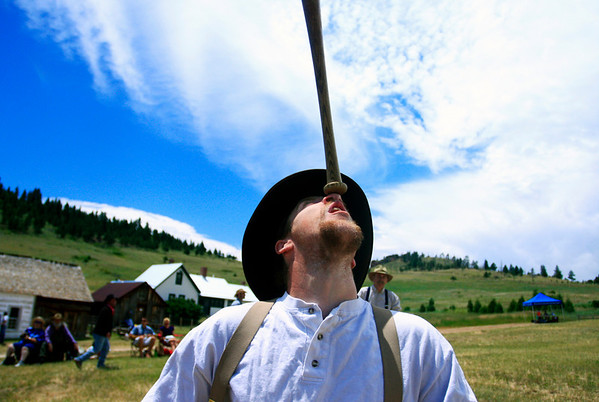 Dathan 'Cannibal' Tinney warms up by balancing a bat on his nose prior to the start of the vintage baseball game between the Walker Ranch Boys and The Excelsiors at Walker Ranch in Boulder on July 25.<br /> Greg Lindstrom / The Camera