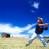 Pete Traxler, who goes by the handle Sneaky Pete Walker, eyes a hurl during the vintage baseball game between the Walker Ranch Boys and The Excelsiors at Walker Ranch in Boulder on July 25.  The Walker Ranch Boys won 19-15 in 11 innings.<br /> Greg Lindstrom / The Camera