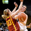Colorado's Meagan Malcolm-Peck (right) collides with USC's Christina Marinacci (left) during their basketball game at the University of Colorado in Boulder, Colorado January 26, 2012.  . CAMERA/MARK LEFFINGWELL