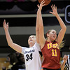 Colorado's Jen Resse (left) and USC's Cassie Harberts reach for a loose ball during their basketball game at the University of Colorado in Boulder, Colorado January 26, 2012.  . CAMERA/MARK LEFFINGWELL