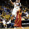 Colorado's Brittany Wilson (left) takes a shot over USC's Ashley Corral (right) during their basketball game at the University of Colorado in Boulder, Colorado January 26, 2012.  . CAMERA/MARK LEFFINGWELL