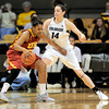 Colorado's Meagan Malcolm-Peck (right) pressures USC's Stefanie Gilbreath (left) during their basketball game at the University of Colorado in Boulder, Colorado January 26, 2012.  . CAMERA/MARK LEFFINGWELL