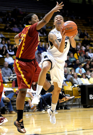 Colorado's Chucky Jeffery (right) is fouled by USC's Dominique Scott (left) during their basketball game at the University of Colorado in Boulder, Colorado January 26, 2012.  . CAMERA/MARK LEFFINGWELL
