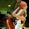 Colorado's Julie Seabrook pushes through USC's Desiree Bradley's reach for a shot during their basketball game at the University of Colorado in Boulder, Colorado January 26, 2012.  . CAMERA/MARK LEFFINGWELL