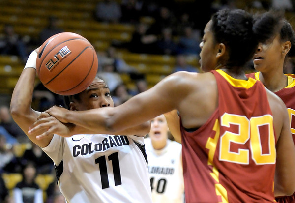 Colorado's Brittany Wilson (left) is fouled by USC's Stefanie Gilbreath (right) during their basketball game at the University of Colorado in Boulder, Colorado January 26, 2012.  . CAMERA/MARK LEFFINGWELL