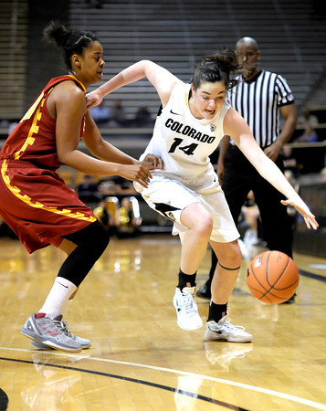 Colorado's Meagan Malcolm-Peck (right) pushes past USC's Stefanie Gilbreath (left) during their basketball game at the University of Colorado in Boulder, Colorado January 26, 2012.  . CAMERA/MARK LEFFINGWELL