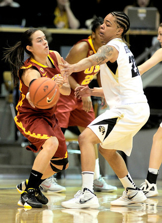 USC's Ashley Corral (left) passes the ball around Colorado's Chucky Jeffery (right) during their basketball game at the University of Colorado in Boulder, Colorado January 26, 2012.  . CAMERA/MARK LEFFINGWELL