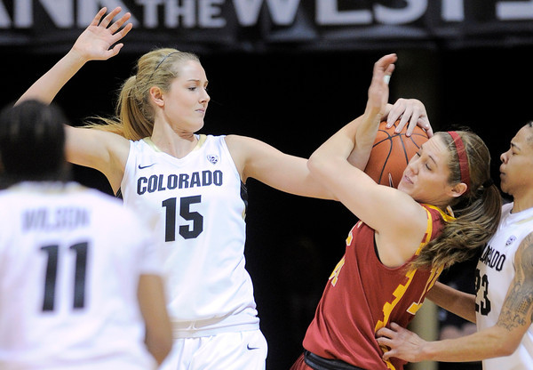 Colorado's Julie Seabrook (left) wrestles USC's Cassie Harberts (right) for a loose ball during their basketball game at the University of Colorado in Boulder, Colorado January 26, 2012.  . CAMERA/MARK LEFFINGWELL