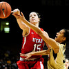 Colorado's Arielle Roberson (right) is fouled by Utah's Michelle Plouffe (left) during their basketball game at the University of Colorado in Boulder , Colorado January 8, 2013. BOULDER DAILY CAMERA/ Mark Leffingwell