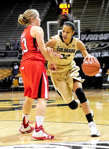 Colorado's Arielle Roberson (right) fights past Utah's Rachel Messer (left) during their basketball game at the University of Colorado in Boulder , Colorado January 8, 2013. BOULDER DAILY CAMERA/ Mark Leffingwell