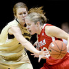 Colorado's Rachel Hargis (left) bats the ball away from Utah's Rachel Messer (right) during their basketball game at the University of Colorado in Boulder , Colorado January 8, 2013. BOULDER DAILY CAMERA/ Mark Leffingwell