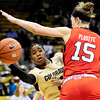 Colorado's Brittany Wilson (left) passes the ball under the reach of Utah's Michelle Plouffe (right) during their basketball game at the University of Colorado in Boulder , Colorado January 8, 2013. BOULDER DAILY CAMERA/ Mark Leffingwell