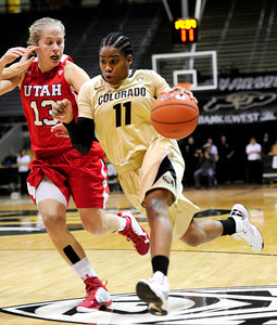 Colorado's Brittany Wilson (right) drive in for a shot while being guarded by Utah's Rachel Messer (left) during their basketball game at the University of Colorado in Boulder , Colorado January 8, 2013. BOULDER DAILY CAMERA/ Mark Leffingwell
