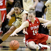 Colorado's Jasmine Sborov (left) and Utah's Paige Crozon (right) dive for a loose ball during their basketball game at the University of Colorado in Boulder , Colorado January 8, 2013. BOULDER DAILY CAMERA/ Mark Leffingwell