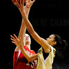 Colorado's Arielle Roberson (right) takes a shot while under pressure from Utah's Michelle Plouffe (left) during their basketball game at the University of Colorado in Boulder , Colorado January 8, 2013. BOULDER DAILY CAMERA/ Mark Leffingwell