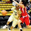 Colorado's Brittany Wilson (left) slides past Utah's Danielle Rodriguez (right) for a shot during their basketball game at the University of Colorado in Boulder , Colorado January 8, 2013. BOULDER DAILY CAMERA/ Mark Leffingwell