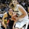 Colorado's Rachel Hargis (right) gets past Arizona's Aley Rohde (left) for a shot during their basketball game at the University of Colorado in Boulder, Colorado February 9, 2012. CAMERA/MARK LEFFINGWELL