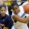 "Ashley Wilson of Colorado grabs a rebound from Shanita Arnold of Arizona during the first half of the February 9, 2012 game in Boulder.<br /> For more photos of the game, go to  <a href=""http://www.dailycamera.com"">http://www.dailycamera.com</a>.<br /> February 9, 2012 / Cliff Grassmick"