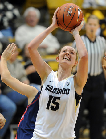 """Julie Seabrook of CU scores against Arizona<br /> during the first half of the February 9, 2012 game in Boulder.<br /> For more photos of the game, go to  <a href=""""http://www.dailycamera.com"""">http://www.dailycamera.com</a>.<br /> February 9, 2012 / Cliff Grassmick"""
