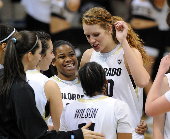 """Ashley Wilson, left, and Rachel Hargis of CU, celebrate the win over Arizona during the second half of the February 9, 2012 game in Boulder.<br /> For more photos of the game, go to  <a href=""""http://www.dailycamera.com"""">http://www.dailycamera.com</a>.<br /> February 9, 2012 / Cliff Grassmick"""