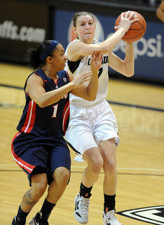"Lexy Kresl of CU drives past Candice Warthen of Arizona<br /> during the second half of the February 9, 2012 game in Boulder.<br /> For more photos of the game, go to  <a href=""http://www.dailycamera.com"">http://www.dailycamera.com</a>.<br /> February 9, 2012 / Cliff Grassmick"