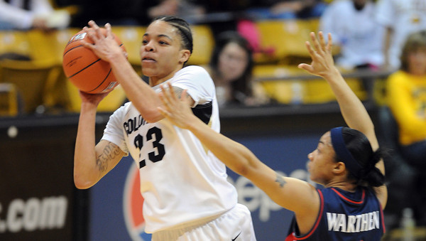 """Chucky Jeffery of CU gets a shot off over Candice Warthen of Arizona<br /> during the first half of the February 9, 2012 game in Boulder.<br /> For more photos of the game, go to  <a href=""""http://www.dailycamera.com"""">http://www.dailycamera.com</a>.<br /> February 9, 2012 / Cliff Grassmick"""