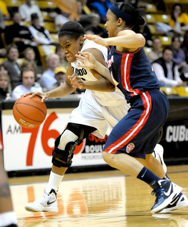 Colorado's Ashley Wilson (left) drives toward the goal while being pressured by Arizona's Candice Warthen (right) during their basketball game at the University of Colorado in Boulder, Colorado February 9, 2012. CAMERA/MARK LEFFINGWELL