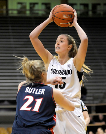 Colorado's Julie Seabrook (right) looks to pass while being guarded by Arizona's Erin Butler (left) during their basketball game at the University of Colorado in Boulder, Colorado February 9, 2012. CAMERA/MARK LEFFINGWELL