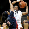Colorado's Brittany Wilson (right) beats Arizona's Shanita Arnold (left) to a rebound during their basketball game at the University of Colorado in Boulder, Colorado February 9, 2012. CAMERA/MARK LEFFINGWELL