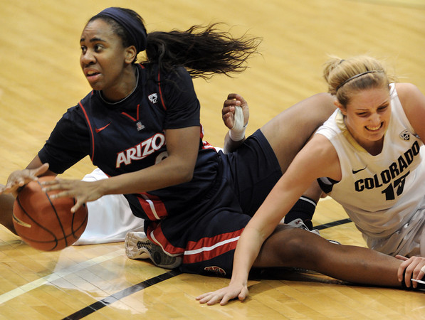 Davellyn Whyte, left, of Arizona gets the loose ball from Julie Seabrook of Colorado during the second half of the February 9, 2012 game in Boulder.<br /> February 9, 2012 / Cliff Grassmick