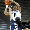 Colorado's Brittany Wilson (back) makes a 3-point-shot over Arizona's Shanita Arnold (front) during their basketball game at the University of Colorado in Boulder, Colorado February 9, 2012. CAMERA/MARK LEFFINGWELL