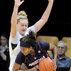 Arizona's Reiko Thomas (right) tries to get past Colorado's Jen Reese (left) during their basketball game at the University of Colorado in Boulder, Colorado February 9, 2012. CAMERA/MARK LEFFINGWELL