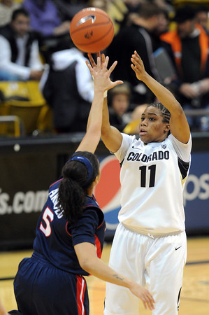 """Brittany Wilson of Colorado shoots over Shanita Arnold of Arizona<br /> during the first half of the February 9, 2012 game in Boulder.<br /> For more photos of the game, go to  <a href=""""http://www.dailycamera.com"""">http://www.dailycamera.com</a>.<br /> February 9, 2012 / Cliff Grassmick"""