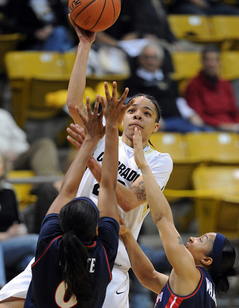 """Chucky Jeffery of CU puts a shot over Davellyn Whyte of Arizona<br /> during the first half of the February 9, 2012 game in Boulder.<br /> For more photos of the game, go to  <a href=""""http://www.dailycamera.com"""">http://www.dailycamera.com</a>.<br /> February 9, 2012 / Cliff Grassmick"""