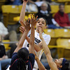 "Chucky Jeffery of CU puts a shot over Davellyn Whyte of Arizona<br /> during the first half of the February 9, 2012 game in Boulder.<br /> For more photos of the game, go to  <a href=""http://www.dailycamera.com"">http://www.dailycamera.com</a>.<br /> February 9, 2012 / Cliff Grassmick"