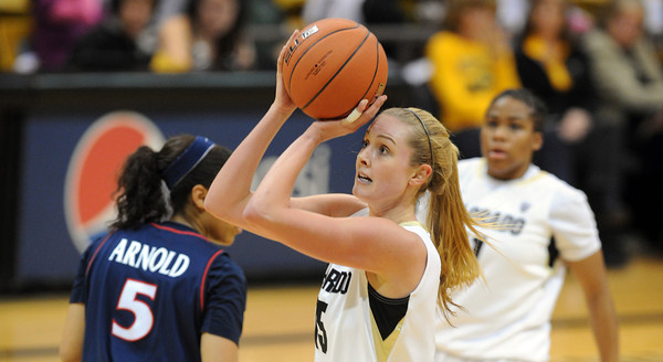 """Julie Seabrook of Colorado shoots from the outside against Arizona<br /> during the first half of the February 9, 2012 game in Boulder.<br /> For more photos of the game, go to  <a href=""""http://www.dailycamera.com"""">http://www.dailycamera.com</a>.<br /> February 9, 2012 / Cliff Grassmick"""