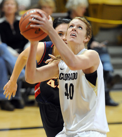 """Rachel Hargis of CU gets past Aley Rohde of Arizona<br /> during the first half of the February 9, 2012 game in Boulder.<br /> For more photos of the game, go to  <a href=""""http://www.dailycamera.com"""">http://www.dailycamera.com</a>.<br /> February 9, 2012 / Cliff Grassmick"""
