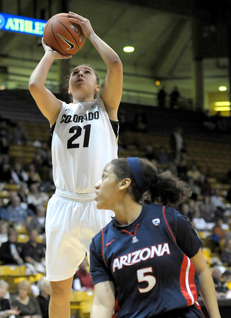 Colorado's Jasmine Sborov (left) takes a shot over Arizona's Shanita Arnold (right) during their basketball game at the University of Colorado in Boulder, Colorado February 9, 2012. CAMERA/MARK LEFFINGWELL