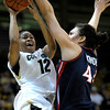 Colorado's Ashley Wilson (left) fights through Arizona's Aley Rohde (right) for a shot during their basketball game at the University of Colorado in Boulder, Colorado February 9, 2012. CAMERA/MARK LEFFINGWELL