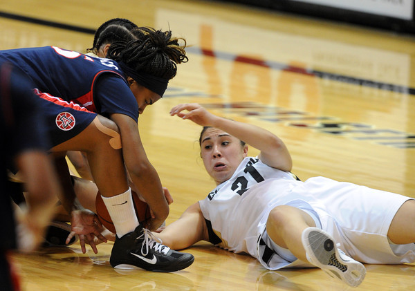 """Jasmine Sborov, right, tries to get a loose ball from Reiko Thomas of Arizona during the second half of the February 9, 2012 game in Boulder.<br /> For more photos of the game, go to  <a href=""""http://www.dailycamera.com"""">http://www.dailycamera.com</a>.<br /> February 9, 2012 / Cliff Grassmick"""