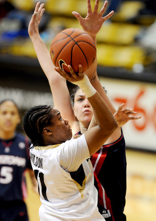 Brittany Wilson of Colorado tries to shoot over Aley Rohde of Arizona<br /> during the second half of the February 9, 2012 game in Boulder.<br /> February 9, 2012 / Cliff Grassmick