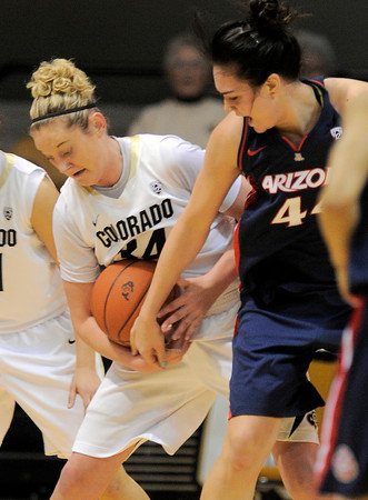 Colorado's Jen Reese (left) steals the ball from Arizona's Aley Hohde (right) during their basketball game at the University of Colorado in Boulder, Colorado February 9, 2012. CAMERA/MARK LEFFINGWELL