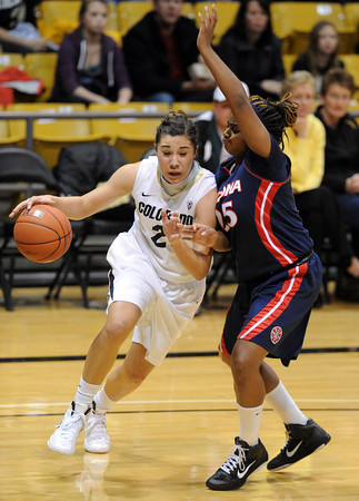 "Jasmine Sborov of CU drives on Reiko Thomas of Arizona<br /> during the first half of the February 9, 2012 game in Boulder.<br /> For more photos of the game, go to  <a href=""http://www.dailycamera.com"">http://www.dailycamera.com</a>.<br /> February 9, 2012 / Cliff Grassmick"