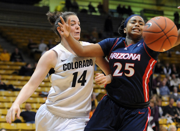 Meagan Malcolm-Peck, left, of Colorado and Reiko Thomas of Arizona track down a rebound during the first half of the February 9, 2012 game in Boulder.<br /> February 9, 2012 / Cliff Grassmick