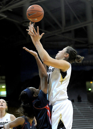 Colorado's Jasmine Sborov (right) makes the shot and draws the foul from Arizona's Davellyn Whyte (left) during their basketball game at the University of Colorado in Boulder, Colorado February 9, 2012. CAMERA/MARK LEFFINGWELL