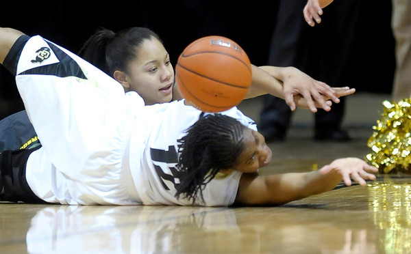 Colorado's Ashley Wilson (right) and Oregon's Ariel Thomas (left) go for a loose ball during their basketball game at the University of Colorado in Boulder, Colorado March 1, 2012. CAMERA/MARK LEFFINGWELL