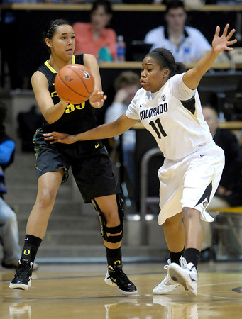 Colorado's Brittany Wilson (right) guards Oregon's Lexi Petersen (left) during their basketball game at the University of Colorado in Boulder, Colorado March 1, 2012. CAMERA/MARK LEFFINGWELL