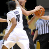 Colorado's Brittany Wilson (left) pressures Oregon's Amanda Johnson (right) during their basketball game at the University of Colorado in Boulder, Colorado March 1, 2012. CAMERA/MARK LEFFINGWELL